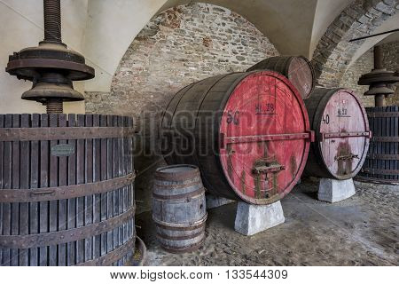Monastero, Italy - May 28, 2016: Wine barrel and winepress in Monastero Bormida in Piedmont Italy