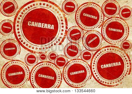 canberra, red stamp on a grunge paper texture