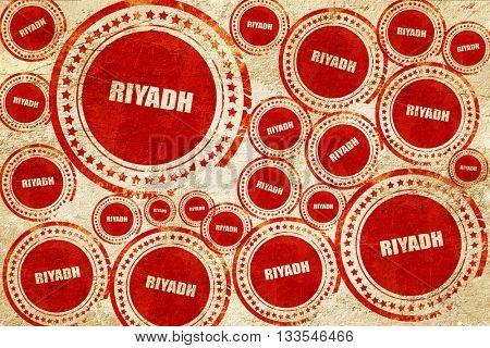 riyadh, red stamp on a grunge paper texture