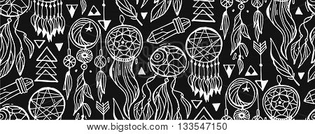 Seamless pattern with freehand dreamcatchers. Ethnic vector illustration on dark background. Black and white wallpaper. Dreamcatchers with feathersgems and arrows.