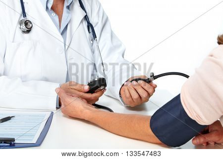 Doctor woman measuring patient blood pressure.