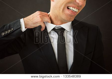 Business man pulling his shirt of his neck