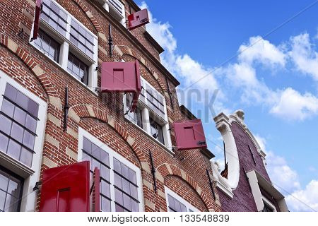 old town house of cobblestone with clear blue sky. Antique, traditional row house in the Netherlands.