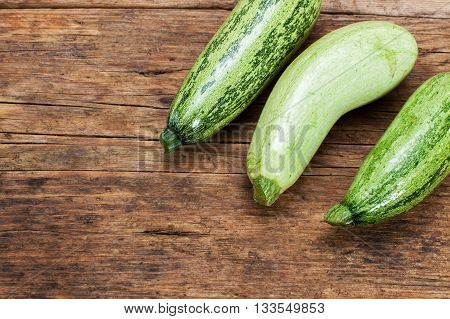 several zucchinies on a wooden table background