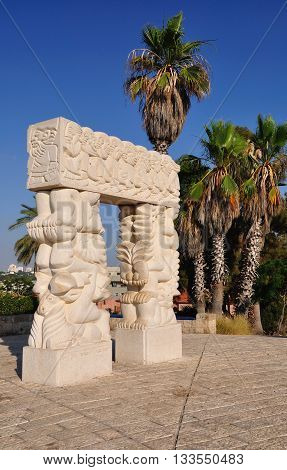 Statue of faith in arch form in abrasha park of old Jaffa. Israel.