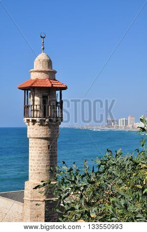 Minaret of old Jaffa mosque and Mediterranean Sea. Israel.