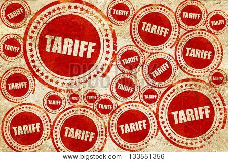 tariff, red stamp on a grunge paper texture