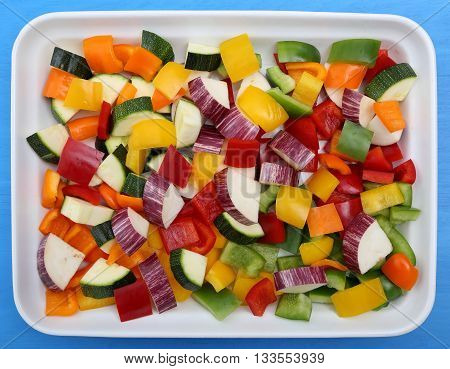 Colored peppers and eggplant chopped into cubes.