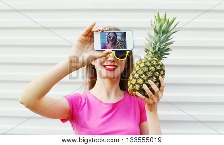 Fashion Cool Girl With Pineapple Taking Picture Self Portrait On Smartphone Over White Background