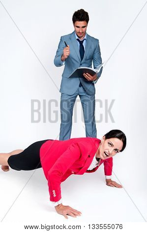 Business situation, a man writes in a notebook while the woman is wrung off the floor