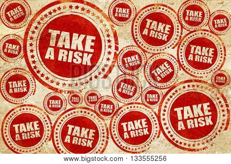 take a risk, red stamp on a grunge paper texture