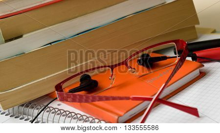 school supplies, for children, students, a stationery lie on paper, earphones from a player, occupations with music, eyepieces
