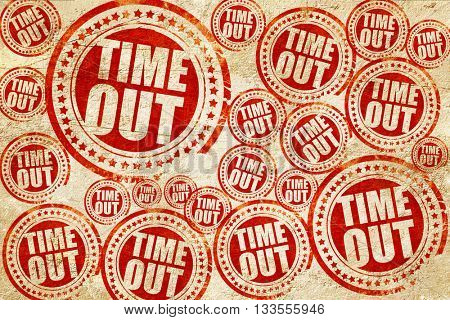 time out, red stamp on a grunge paper texture