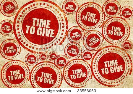 time to give, red stamp on a grunge paper texture