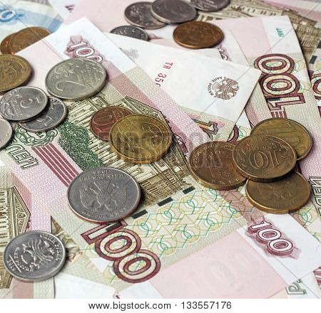 Russian money (paper and coin) on the table top view. Rubles and kopecks. A small amount of money.