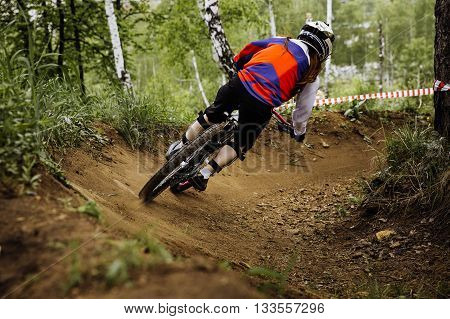 girl athlete mountain biker down from mountain during downhill competition