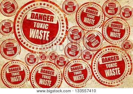Toxic waste sign, red stamp on a grunge paper texture