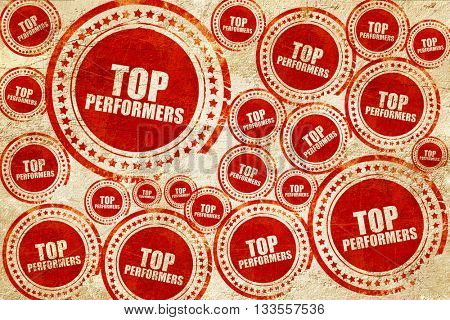 top performers, red stamp on a grunge paper texture