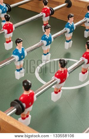 Table football players selective focus on blue player