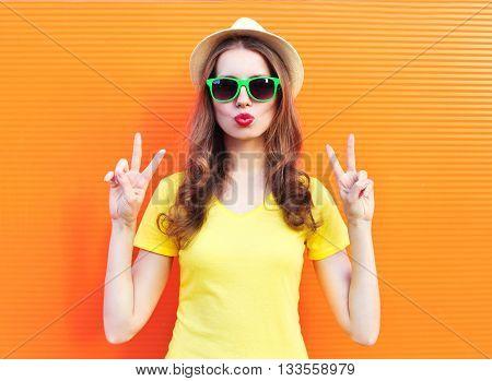 Fashion Pretty Woman In Sunglasses Over Colorful Orange Background