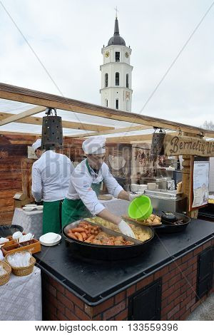 VILNIUS LITHUANIA - MARCH 6: Unidentified people trade food in annual traditional crafts fair - Kaziuko fair on Mar 6 2015 in Vilnius Lithuania