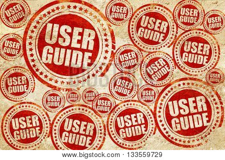 user guide, red stamp on a grunge paper texture