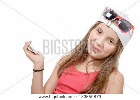 portrait of a preteen girl with a phone isolated on white background