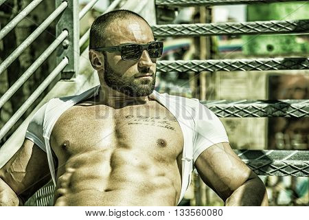 Handsome Muscular Shirtless Hunk Man Outdoor in City Setting. Showing Healthy Body While Looking Away to a Side