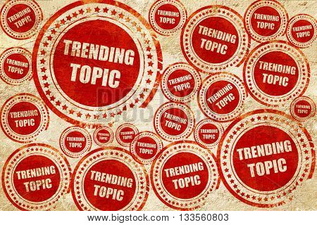 trending topic, red stamp on a grunge paper texture
