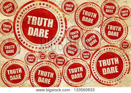 truth or dare, red stamp on a grunge paper texture