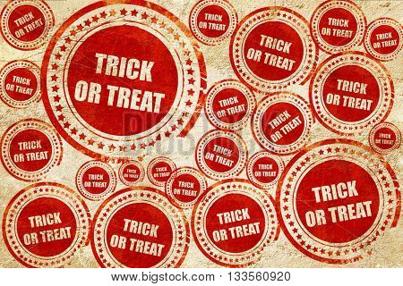 trick or treat, red stamp on a grunge paper texture