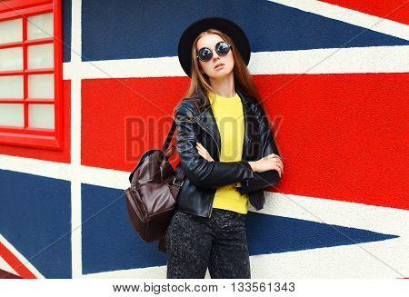 Fashion Pretty Woman Model In Black Rock Style Over Colorful Background