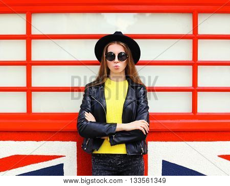 Fashion Pretty Woman Model In Black Rock Style Over Colorful Red Background