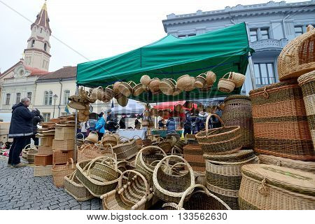VILNIUS, LITHUANIA - MARCH 7: Unidentified people trades hand made basket in annual traditional crafts fair - Kaziuko fair on Mar 7, 2015 in Vilnius, Lithuania