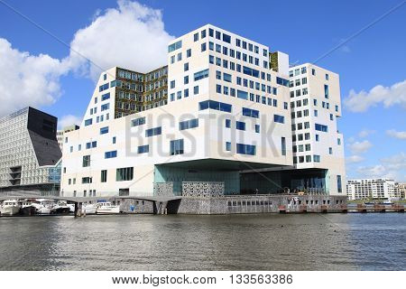 AMSTERDAM, NETHERLANDS - MAY 3, 2016: Modern architecture and Amstel river on IJdock district in Amsterdam, Netherlands
