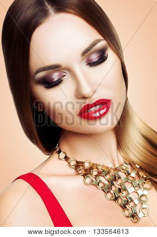 Portrait of beautiful woman with beauty bright evening makeup. The girl advertises eye shadow. Hair straight, smooth, hair. Studio light background