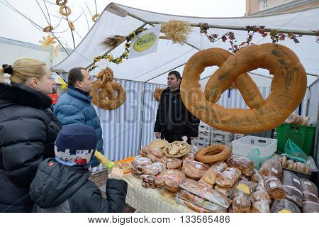 VILNIUS LITHUANIA - MARCH 7: Unidentified people trade home made bread in annual traditional crafts fair - Kaziuko fair on Mar 7 2015 in Vilnius Lithuania