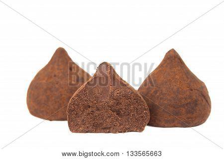 Chocolate dessert truffles isolated on white background