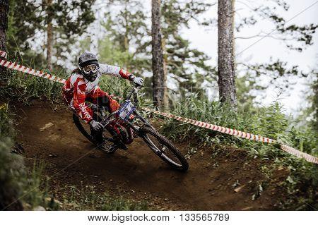 Miass Russia - May 29 2016: woman athlete mountain biking around sharp turn during Cup