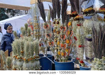 VILNIUS, LITHUANIA - MARCH 8: Unidentified people trade traditional palm bouquets in annual traditional crafts fair - Kaziuko fair on Mar 8, 2015 in Vilnius, Lithuania