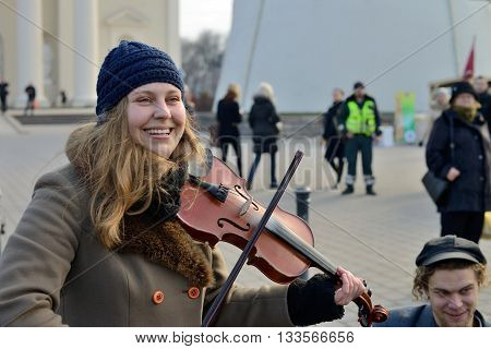 VILNIUS LITHUANIA - MARCH 8: Unidentified musician in annual traditional crafts fair - Kaziuko fair on Mar 8 2015 in Vilnius Lithuania