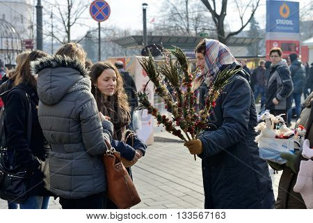 VILNIUS LITHUANIA - MARCH 8: Unidentified people trade traditional palm bouquets in annual traditional crafts fair - Kaziuko fair on Mar 8 2015 in Vilnius Lithuania