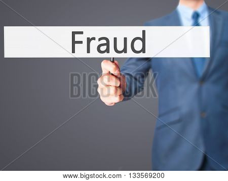 Fraud - Businessman Hand Holding Sign