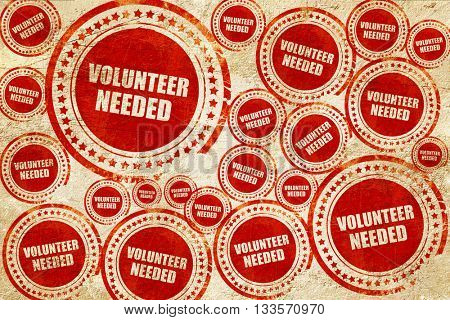 volunteer needed, red stamp on a grunge paper texture