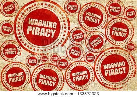 warning piracy, red stamp on a grunge paper texture