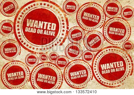 wanted dead or alive, red stamp on a grunge paper texture