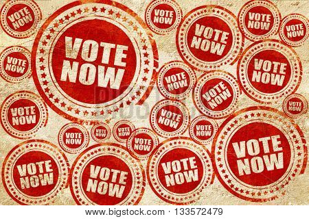 vote now, red stamp on a grunge paper texture