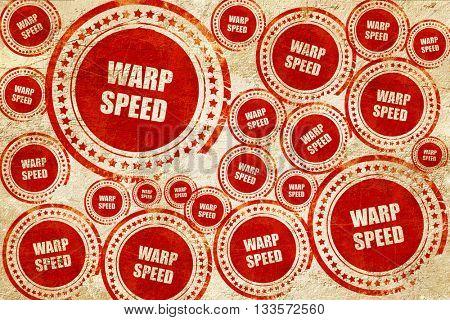 warp speed, red stamp on a grunge paper texture