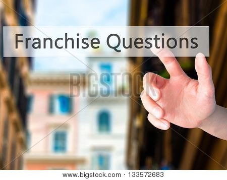 Franchise Questions - Hand Pressing A Button On Blurred Background Concept On Visual Screen.