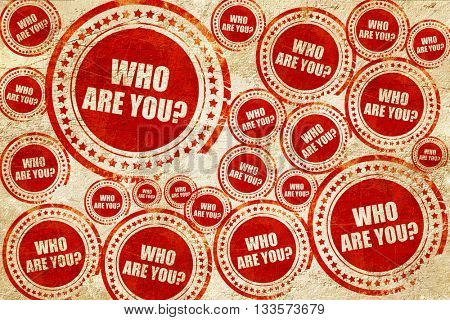 who are you?, red stamp on a grunge paper texture